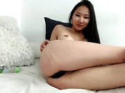 Asian teen toying her pussy