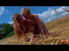 Teens fucking in a field of wheat