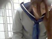 Japanese teen rubs cunt