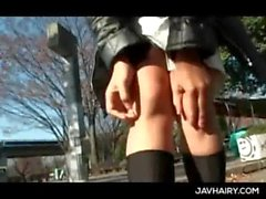 Teen nasty jap girl rubbing her cunt and flashing tits in public