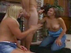 Sexy girls take turns sucking that big cock