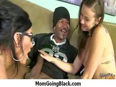 Horny MILF fucks young black stud 14