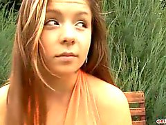 Enjoy a teen striptease outdoors