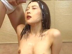 Desirous Japanese babe has her face soaked in nut butter at a raunchy bukkake action