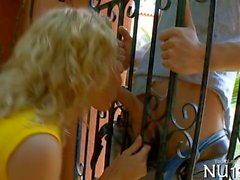 very sweet teen sucking the dick through the fence