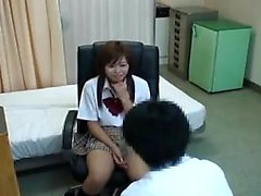 Pretty Japanese schoolgirl has a doctor carefully examining