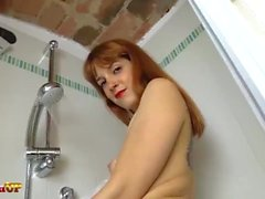 Irina Vega takes a shower in black pantyhose