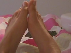 Admire beautiful teenage feet in close up