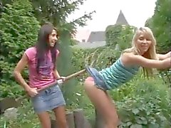 Playful teens have lesbian sex outdoors