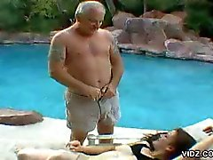 Stunning brunette dame lights up the pool for a horny old man