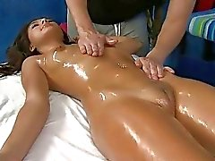Teen with shaved pussy gets fingering in the massage salon