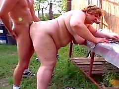 Fat granny sucking young cock in farm