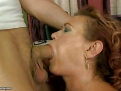 Nasty grandma putting her old mouth to work in a young hard dick