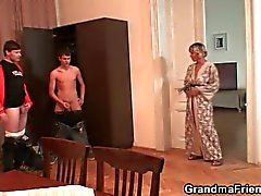 Old bitch gives up her snatch for two young horny studs