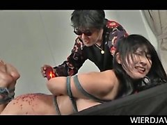 Roped Asian sex slave submitted to sexual torture with hot wax