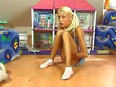 Adorable blonde in pigtails solo tease