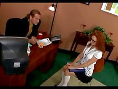 Nerdy redhead secretary Audrey Hollander keeps her job by sucking and fucking the boss