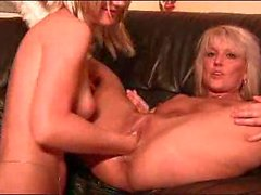 Young lady fisting with mature hottie