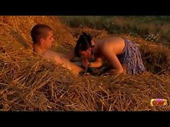 Teens having sex on a pile of hay