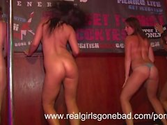 Four sexy girls strip naked on stage for a spring break wet t-shirt contest