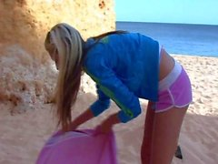 blonde teen at the beach looks so desirable