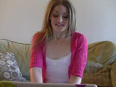 Young blonde gets flirty while chatting on her pc