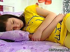 Alena is laying in bed looking sexy in her yellow top thinking about sex on a day like today