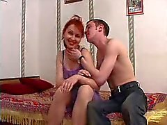 Young man screws older Russian redhead
