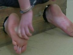Handcuffed Girl shows her petite feet