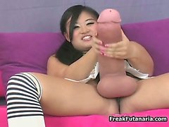 Nasty asian babe rubs her gigantic cock part6