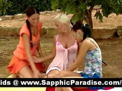 Naughty brunette and blonde lesbos kissing and getting naked in a three way lesbo orgy