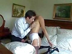 Mature in boots and nylons blows young man
