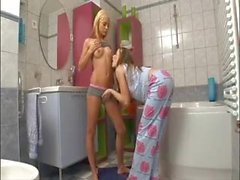 Teens in bathroom use toothbrush in pussy