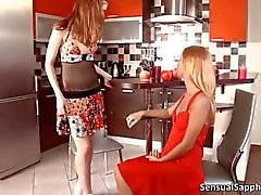 Pale redhead cutie plays with a gorgeous blonde