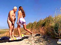 Big busty teen fucks an oldman on the beach