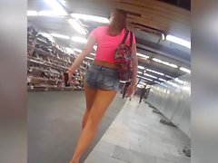 girl in short jeans teasing in public