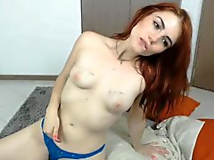 Ravishing young redhead with a phenomenal ass has fun with
