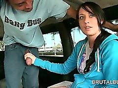 Brunette teen sweetie playing with giant dick in the sex bus