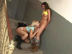 A brunette slut gets her toys out and starts messing with her blonde friend's pussy