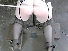 Busty redhead slut gets caned by male master