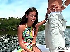 Sweet brunette sucking large hungry pecker on a boat