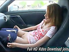 Skinny little teen Maya tickles her clit in public