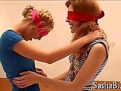 Hot twiggy teens play with blindfolds